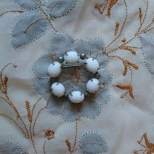Vintage white scarabs circular brooch pin
